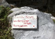 A sign of Zastia Kiosk on the rock