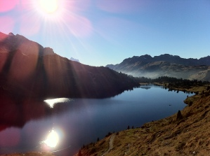 The Engstlensee is shining in the afternoon sun