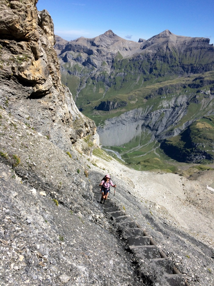 Caroline toiling up the steep stairs.