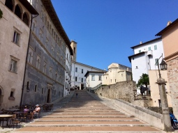 A flight of steps down to the stone cathedral